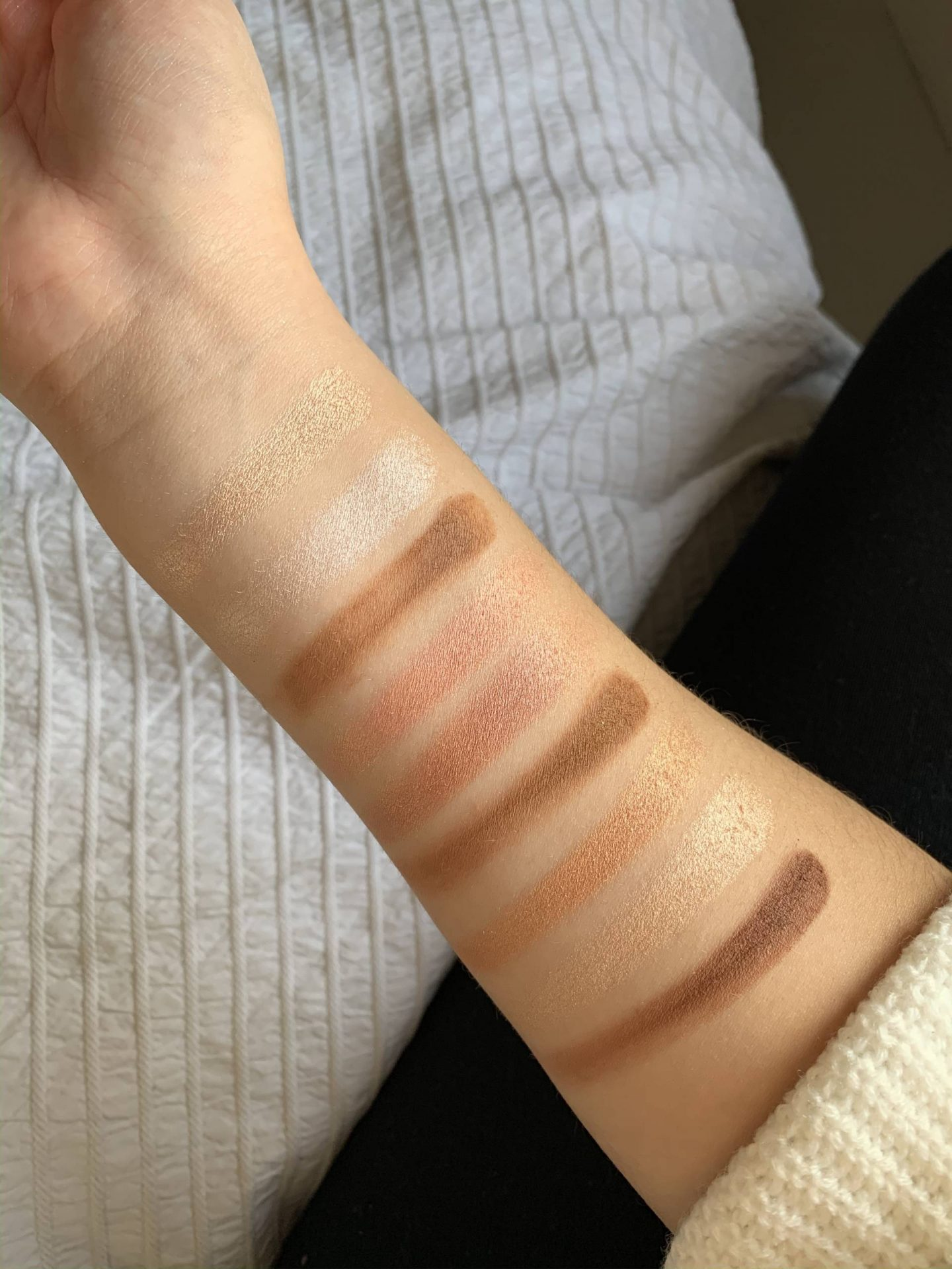 highlight and contour palette swatches on skin