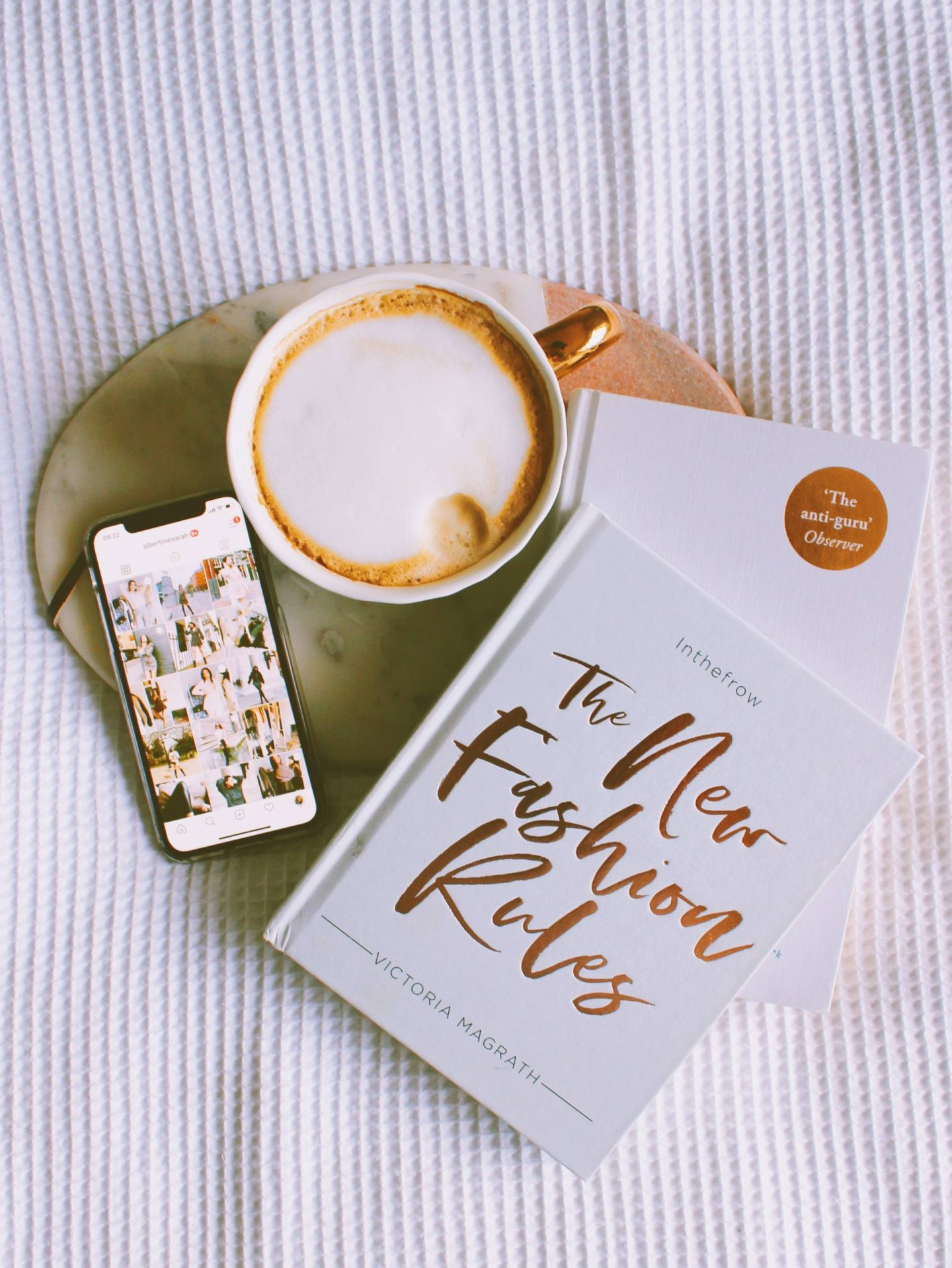 Coffee and books flatlay on marble board