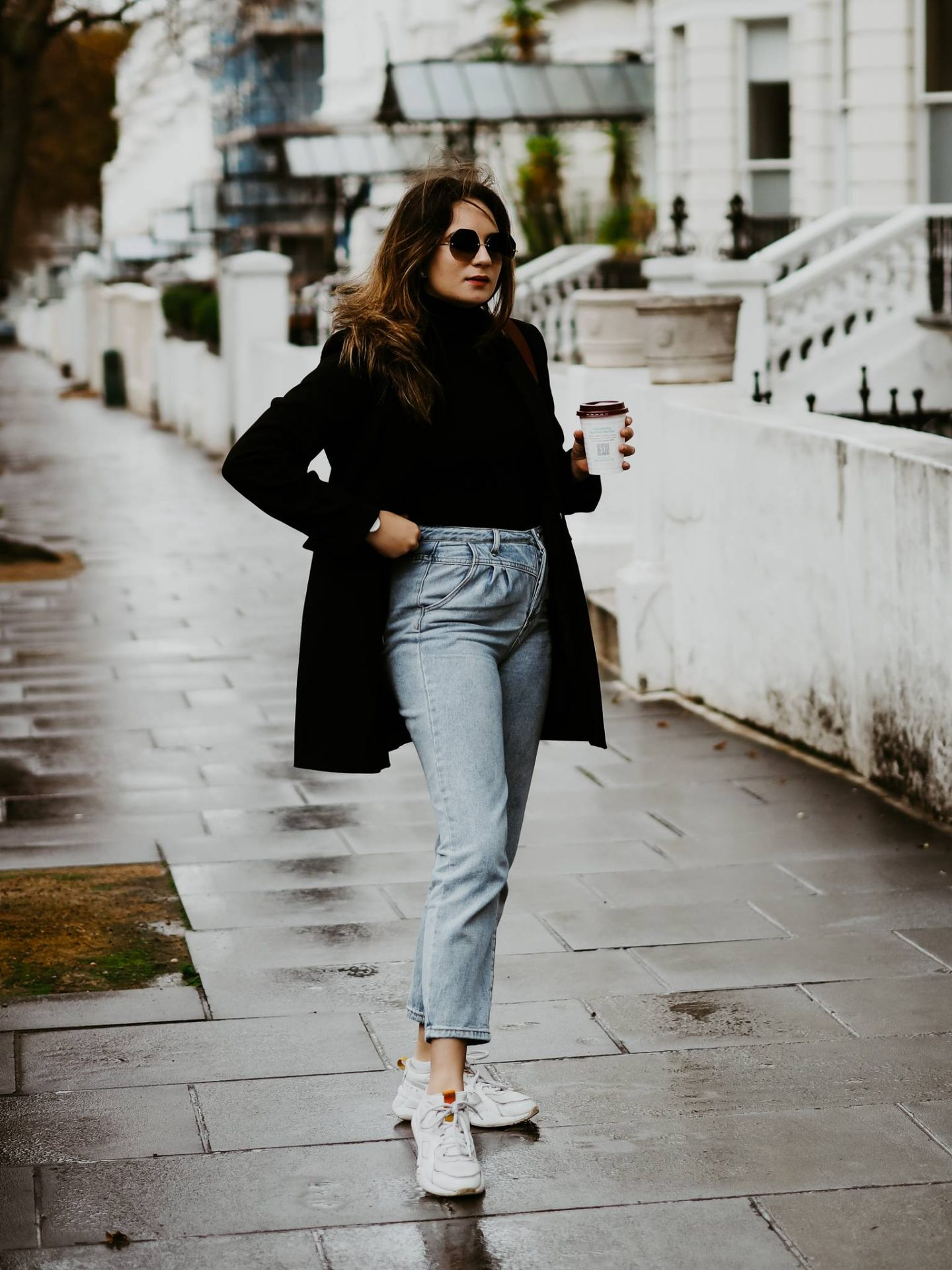 straight leg jeans worn with oversized blazer and chunky trainers
